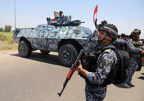 כבשו מחדש את תכרית. צבא עיראק (צילום: AP) (צילום: AP)