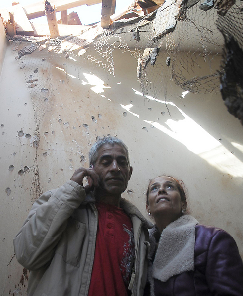 The Shadadi family after their home suffered a direct Kassam hit during Operation Pillar of Defense (Photo: Avi Rokach)