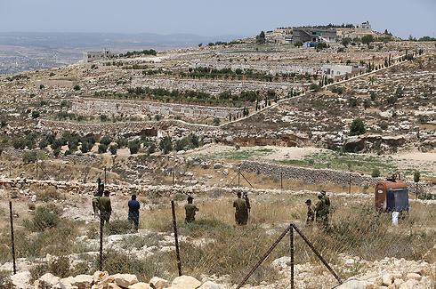 המקום שבו נמצאו הגופות בחלחול        (צילום: גיל יוחנן) (צילום: גיל יוחנן)