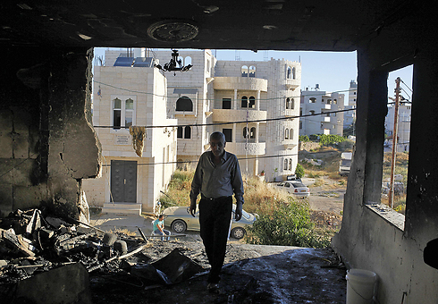 """הבית של אחד מהרוצחים אחרי פעולת צה""""ל (צילום: AP) (צילום: AP)"""