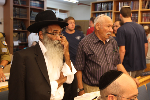 Eyal's grandfather (right) at the synagogue in Elad (Photo: Ido Erez)