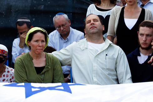 Rachel and Avi Frenkel, Naftali's parents, at the memorial service (Photo: Reuters)