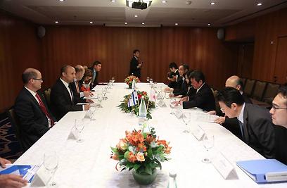Naftali Bennett with Japanese Economy Minister (Photo: Tazpit News Agency)