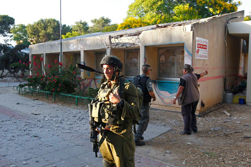 Soldiers moved in to Kfar Aza (Reuters)