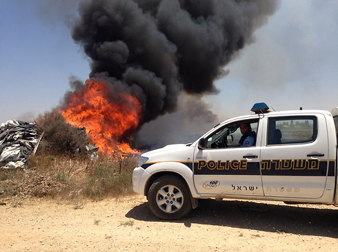 Fire caused by rocket landing in open area (Archive Photo: Police Department Spokesperson)