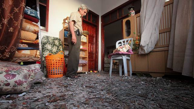 A member of the Rabaee family, whose Hebron house was hit by a Gaza rocket, in his home (Photo: EPA)