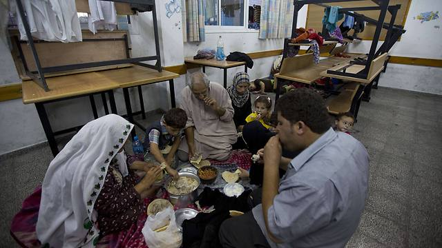 Palestinians breaking the day's Ramadan fast at UNRWA school (Photo: AFP)