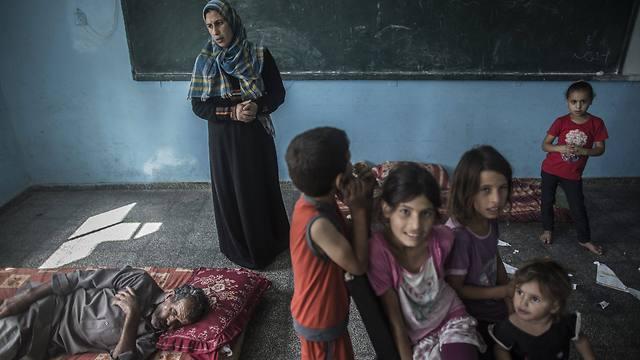 Palestinian children take shelter from IAF strikes (Photo: EPA)