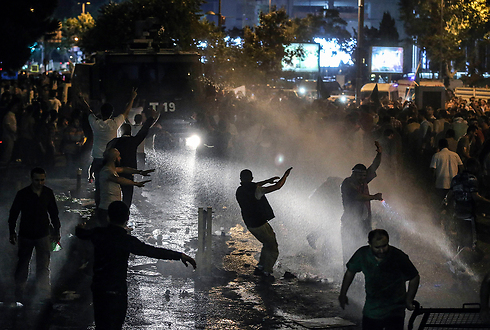 Police fire water cannons (Photo: AP)