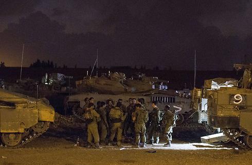Forces outside Gaza (Photo: AFP)