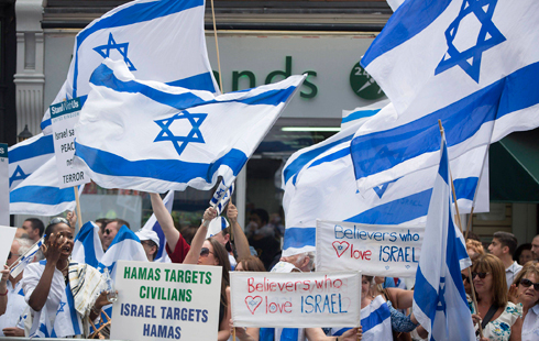 Israel flags and banners (Photo: Reuters) (Photo: Reuters)