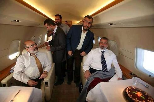 Mashal in a private jet with senior Hamas officials