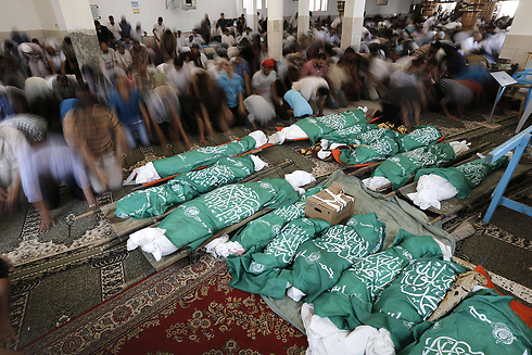 Bodies wrapped in Hamas flags (Photo: AFP)