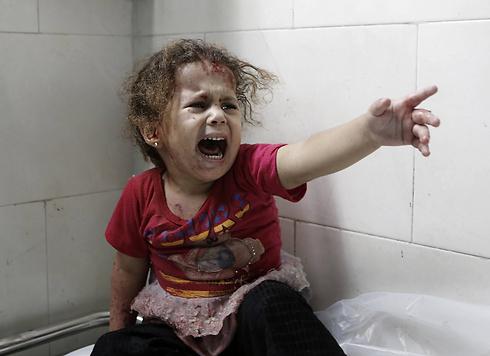 """לפי נתוני האו""""ם, כשליש מההרוגים בעזה הם ילדים (צילום: AFP) (צילום: AFP)"""
