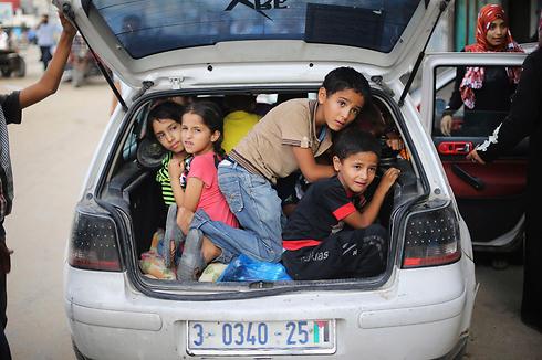 Children leaving their homes in Khan Yunis during Operation Protecitve Edge (Photo: Reuters)