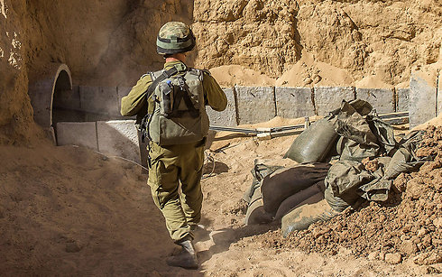 IDF soldiers showing the entrance to a Gaza tunnel (Photo: AFP) (Photo: AFP)