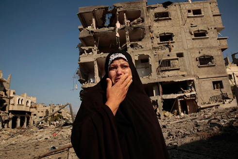 Gazan woman standing among ruins. 'Many Palestinian demands are unrealistic' (Photo: MCT)