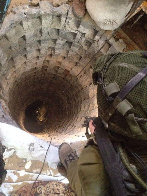 IDF soldiers looking into a terror tunnel in Gaza (Photo: IDF Spokesperson's Unit)