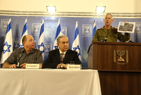 IDF Chief of Staff Gantz holding up a photo proving Gaza terrorists rocket hit Shifa hospital (Photo: Dana Kopel)
