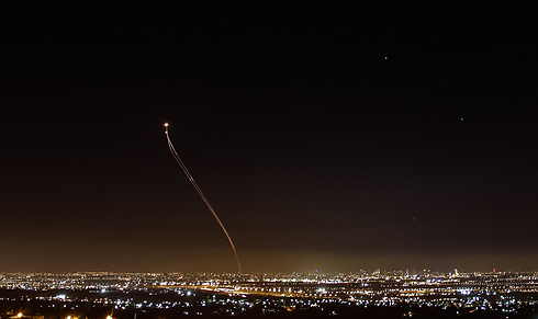 Iron Dome intercepting a rocket over the lights of central Israel. (Photo: Anders Koenig) (Photo: Anders Koenig)