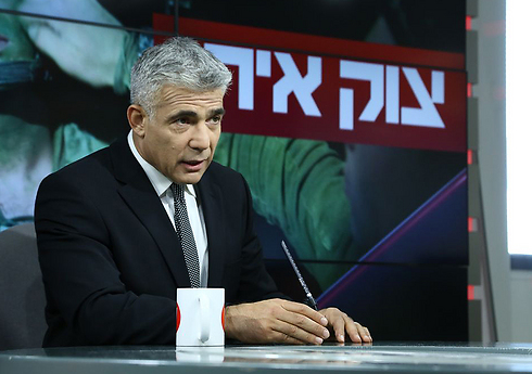 Finance Minister Yair Lapid talking to Ynet (Photo: Ofer Amram)