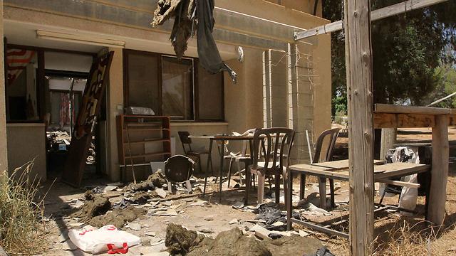 Damage sustained to house next door (Photo: Ido Erez)