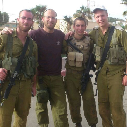 Second Lieutenant Hadar Goldin (second from the right).