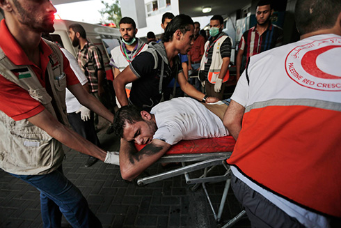Young Palestinian rushed to emergency room at Shifa Hospital (Photo: AP)