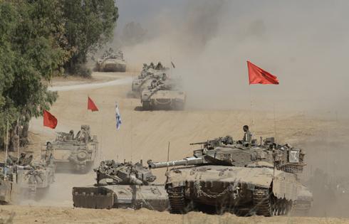 """כוחות צה""""ל יוצאים מהרצועה (צילום: עידו ארז) (צילום: עידו ארז)"""