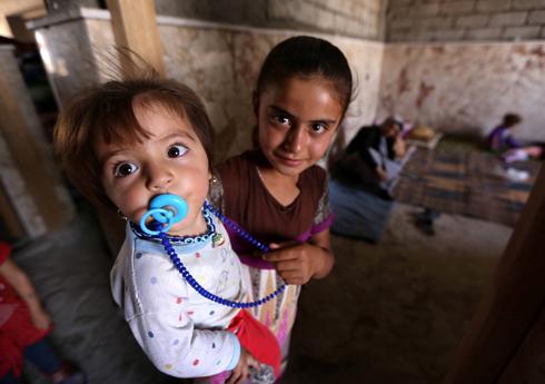 הערכה שמאות נערות ונשים יזידיות נכלאו ונפלו קורבן בידי דאעש (צילום: AFP) (צילום: AFP)