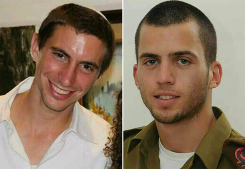 Hadar Goldin (L) and Oron Shaul, whose bodies are being held in Gaza. 'We are proud Israeli families demanding action against Hamas'