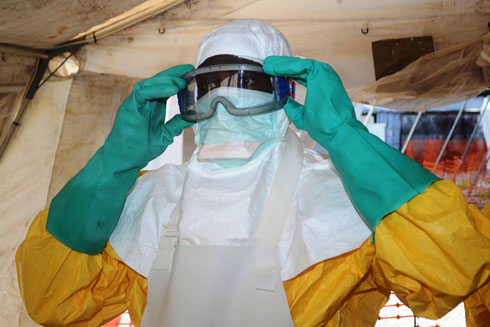 Israeli doctors will treat the patient in full protective gear according to protocol, like this health worker in west Africa. (Photo: AFP) (Photo: AFP)