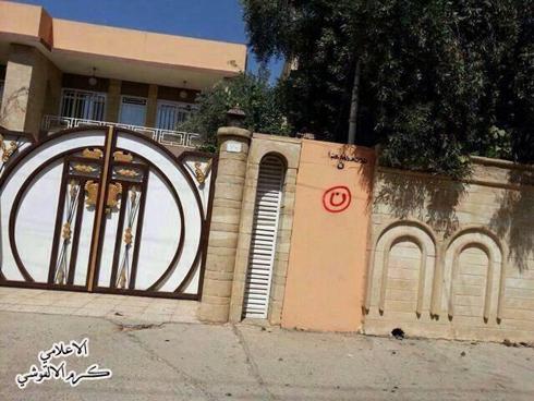 האות נ' על בית של נוצרים בעיראק ()