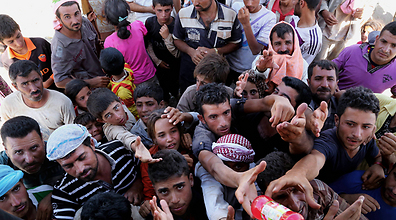Ethnic Yazidi faced potential genocide as they were trapped by ISIS forces in Iraq. (Photo: AP) (Photo: AP)