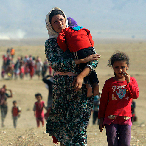 Yazidi refugees escaping ISIS (Photo: Reuters)