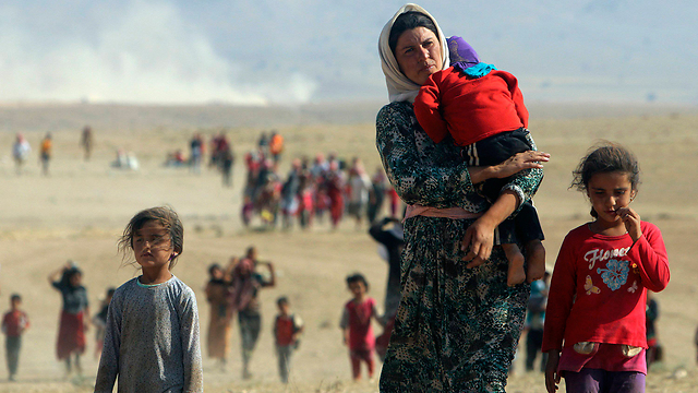 Yazidi refugees escaping the Islamic State in Iraq (Photo: Reuters/File)
