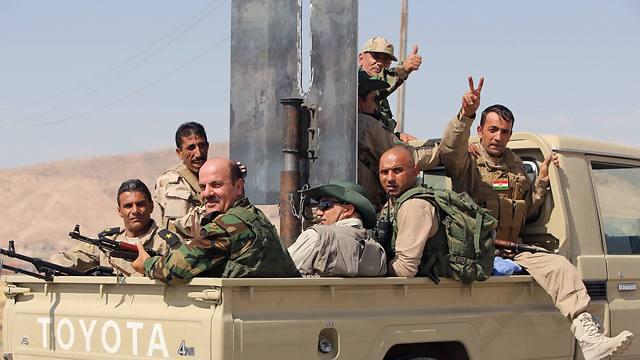 לוחמים כורדים חוגגים (צילום: AFP) (צילום: AFP)