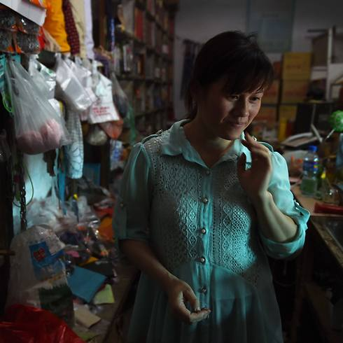 """כלכלית, טוב יותר בסין"". נגויין תאי האנג מווייטנאם (צילום: AFP) (צילום: AFP)"