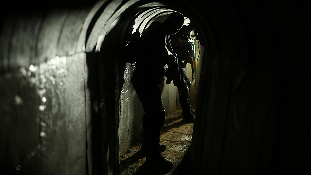 Hamas militant in one of the Gaza tunnels (Reuters)