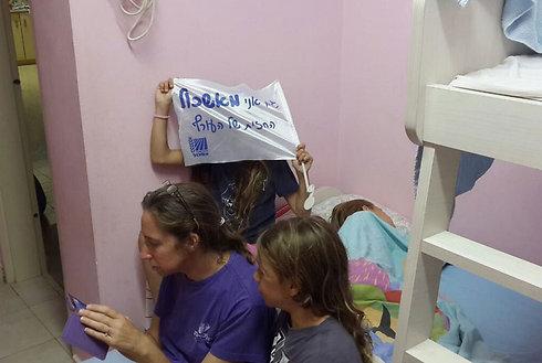 Israelis in Kibbutz Ein Hashlosha on the Gaza border take cover during the summer conflict