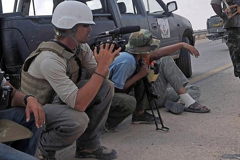 העיתונאי ג'יימס פולי במהלך עבודתו בסוריה (צילום: AFP) (צילום: AFP)