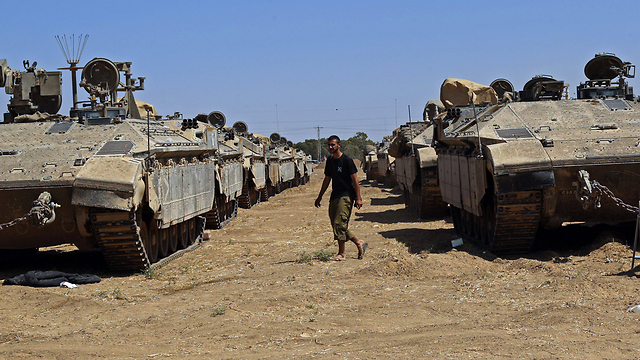 Tanks standing near the Gaza Strip during Operation Protective Edge (Photo: EPA) (Photo: EPA)
