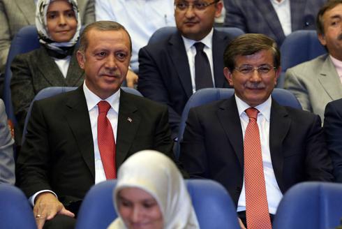 Davutoglu with Turkish President Erdogan (Photo: AFP)