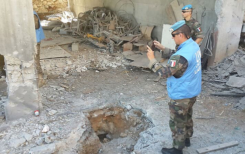 UNIFIL forces at site of rocket hit (Photo: Ahiya Raved)