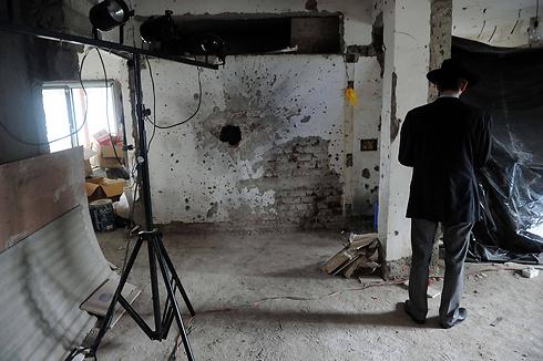 """כתמי דם. בית חב""""ד במומבאי (צילום: AFP) (צילום: AFP)"""