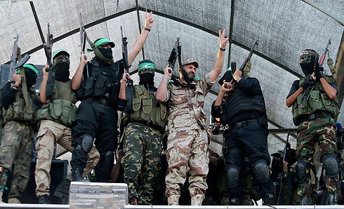 Too busy congratulating themselves. Hamas' celebration following ceasefire (Photo: Reuters)