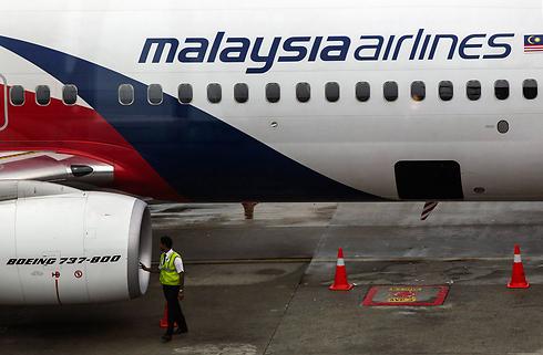"""ניסיון כושל למשוך נוסעים. """"מלזיה אירליינס"""" (צילום: EPA) (צילום: EPA)"""
