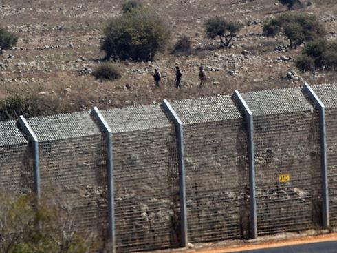 Syrian rebels near border (Photo: EPA)