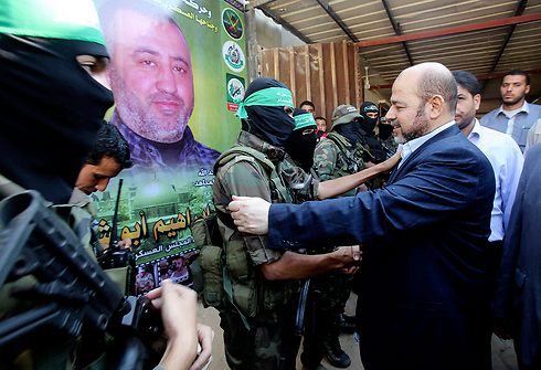 Marzouk with Hamas fighters in Strip (Photo: Reuters)