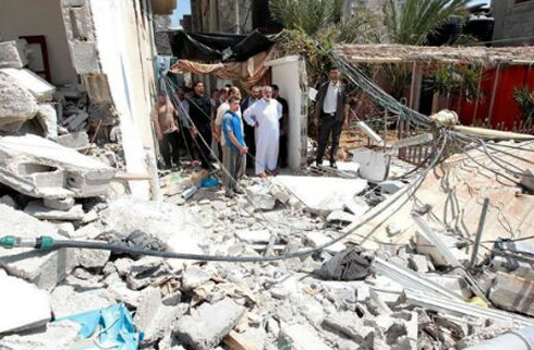 Haniyeh observes the state of his home laying in ruins.